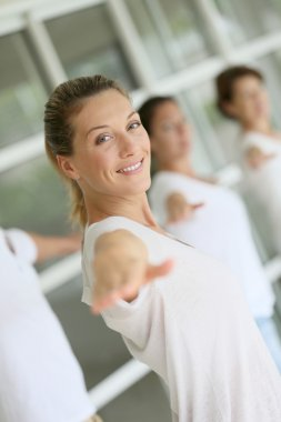 Woman attending yoga course
