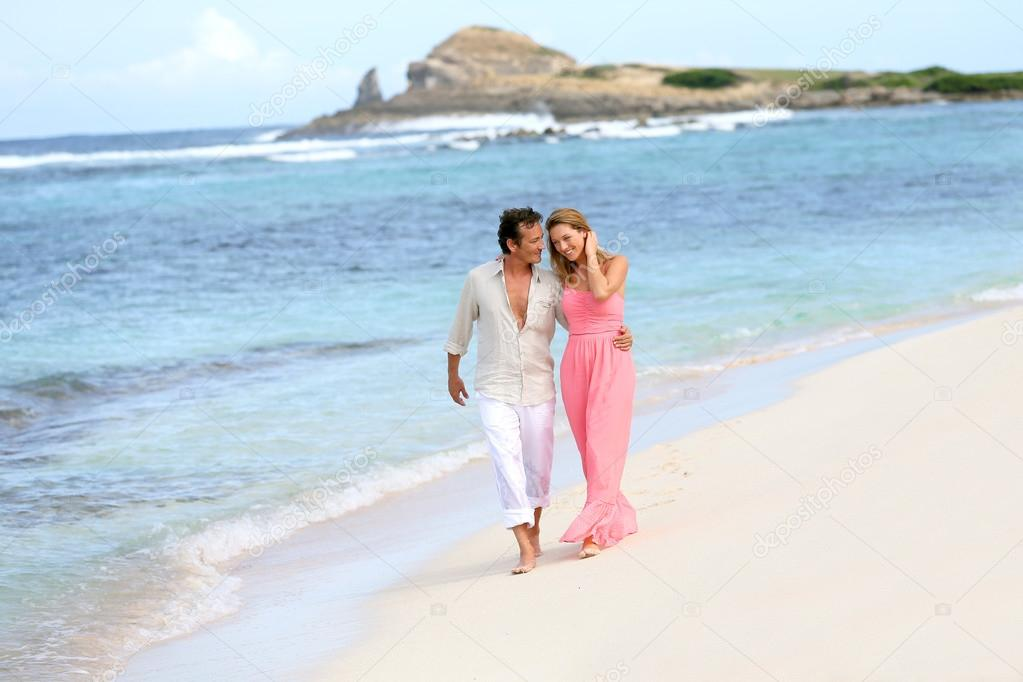Couple walking on sandy beach