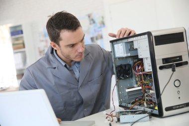 Technician fixing computer hardware