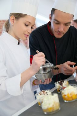 Chef with student in pastry