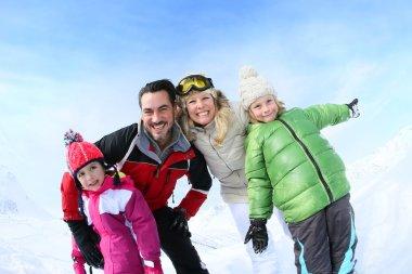 Family enjoying winter vacation