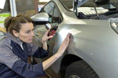 Technician working in auto bodywork shop