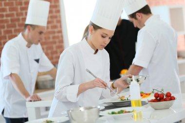 Girl preparing dish