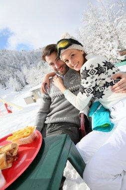 Skiers having snack