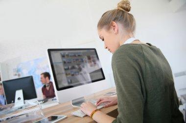 Girl working on desktop computer