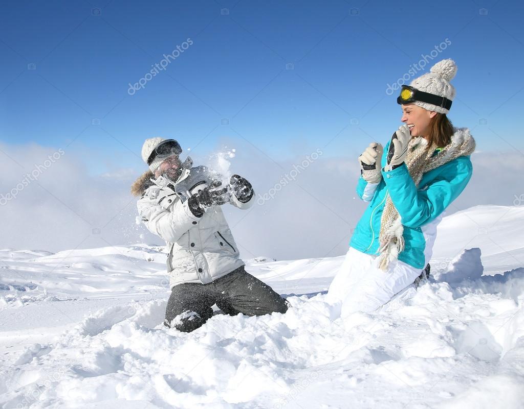 Couple doing snowballs fight