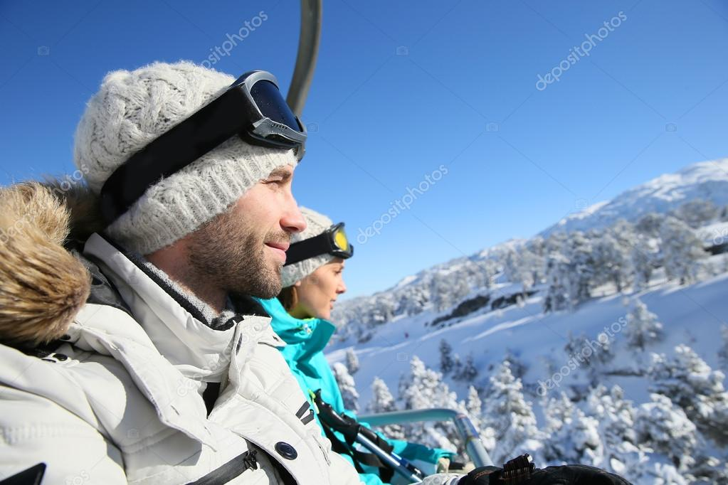 Skiers going up with chairlift