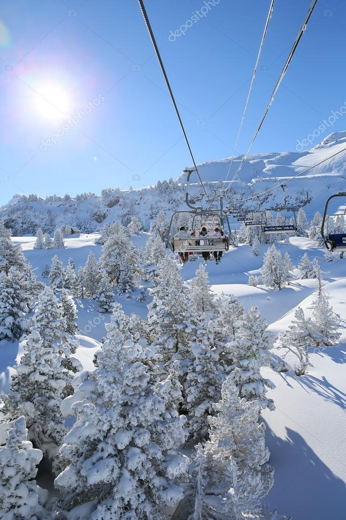 Skiers in chairlift in mountain