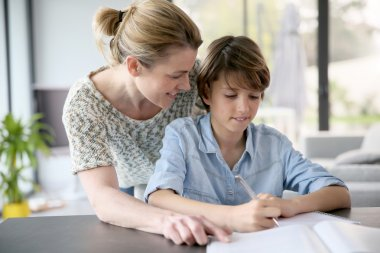 Mother helping with homework