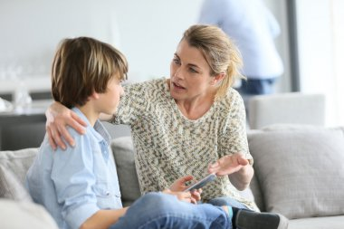 Mother giving warning to boy