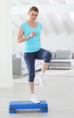 Woman doing step exercises