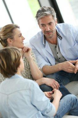 Parents having talk with boy