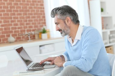 Businessman working from home with laptop