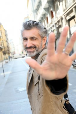 Man showing hand to camera