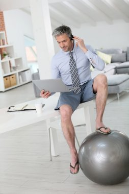 Businessman on video meeting from home