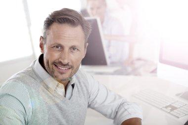 Man in office working on desktop