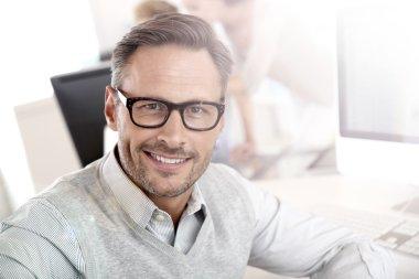 Smiling businessman with eyeglasses