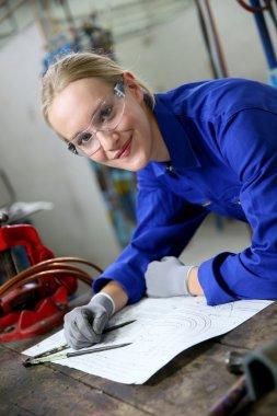 woman apprentice learning plumbing