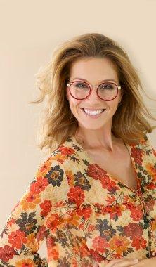 woman in eyeglasses smiling