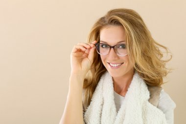 trendy mature woman in  eyeglasses smiling
