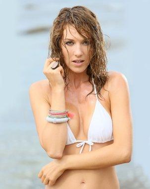 Woman in bikini with wet hair posing