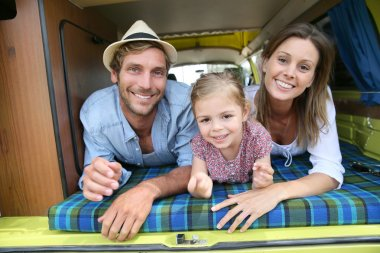 cheerful family having fun in camper