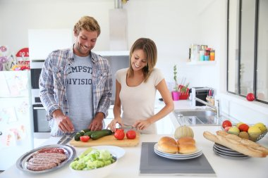 Couple in kitchen preparing lunch