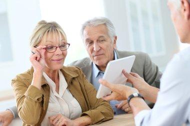 Senior woman choosing eyeglasses