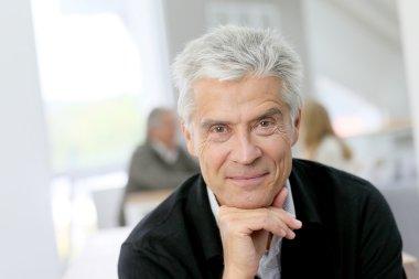 Portrait of smiling senior man posing stock vector