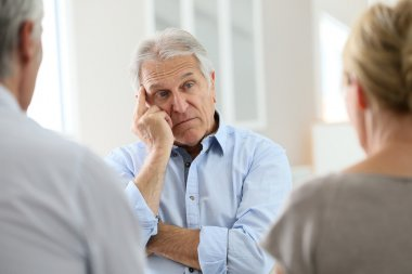 man attending meeting with group therapist