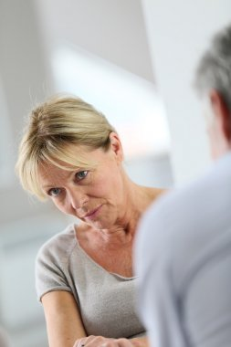 woman attending group therapy