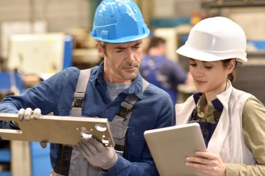 Metallurgy workers using digital tablet