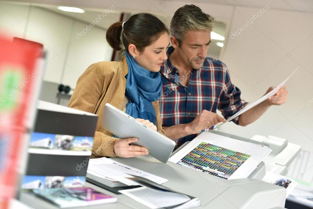 Client in printshop controlling work