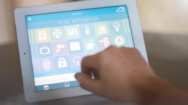 Man use tablet PC with smarthome app to control his house