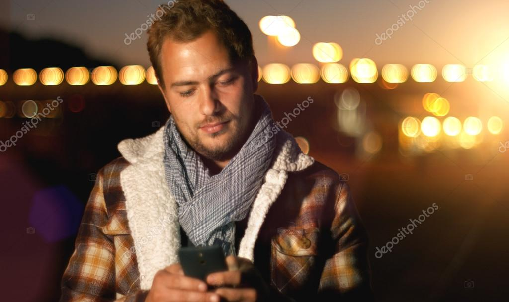 young man sms texting on smartphone