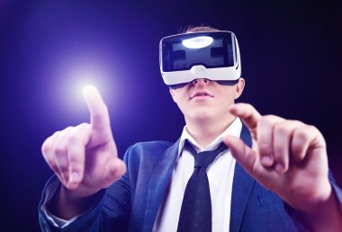Businessman uses Virtual Realitiy VR head-mounted display
