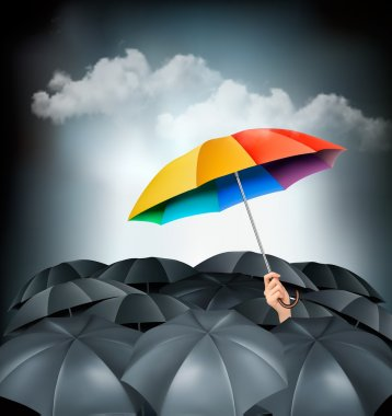 One rainbow umbrella standing out on a grey background. Unique c