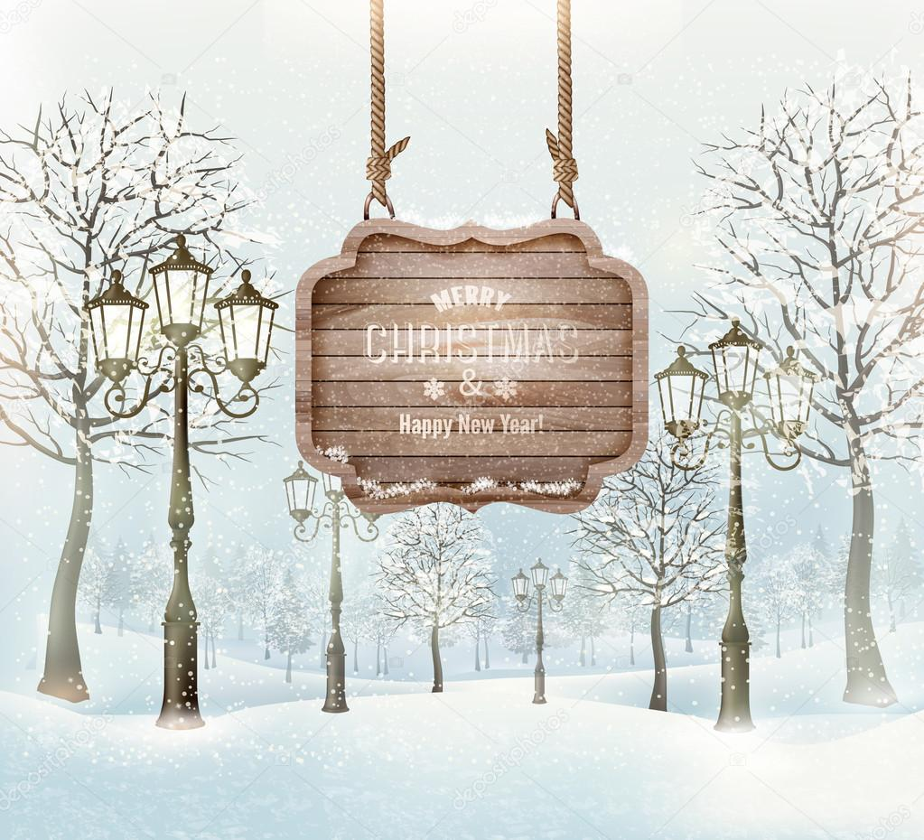 Winter landscape with lampposts and a wooden ornate Merry christ
