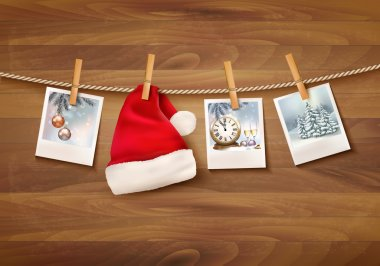 Holiday background with christmas photos and a santa hat. Vector