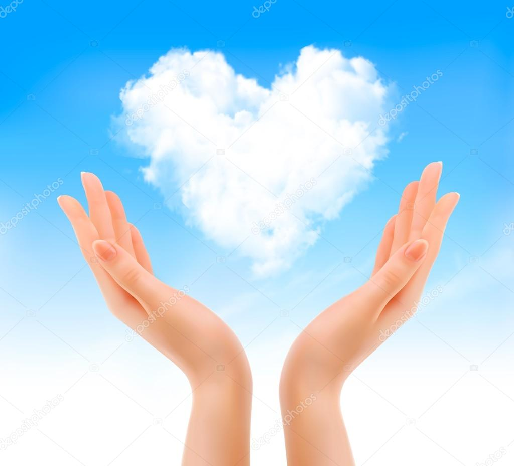Holiday valentine background with hands holding heart shaped clo