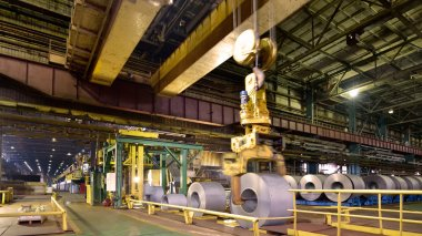 loading of metal on a roll in the plant, steel coils