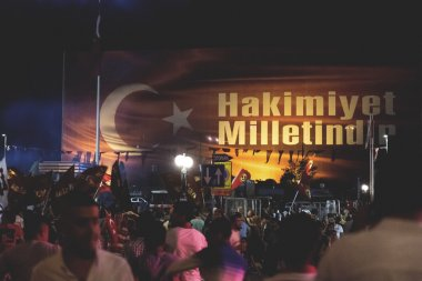 Turkish people gathering and waving flags at Taksim Square. The meetings were called Duty for Democracy after the failed July-15 coup attempt of Gulenist militants.
