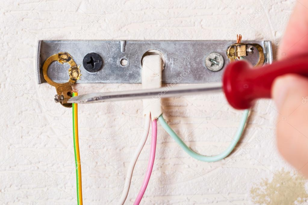 Marvelous Electrician Repairs Wiring In Wall Light Stock Photo C Vvoennyy Wiring Digital Resources Bemuashebarightsorg