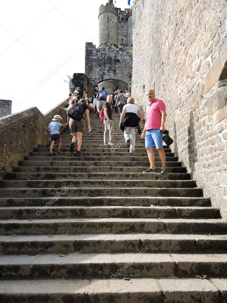 Tourists On Steps To Mont Saint-Michel Abbey