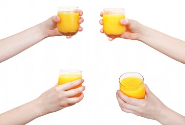 set of hand holds glass with orange juice