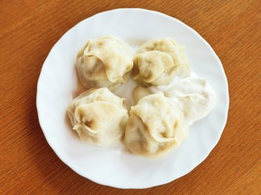 above view of manti dumpling on white plate