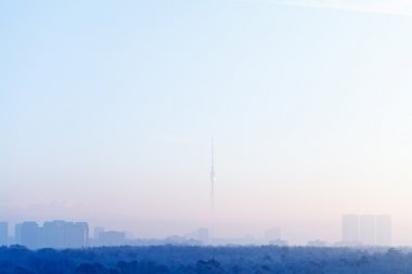 blue sunrise sky over city and TV tower in winter