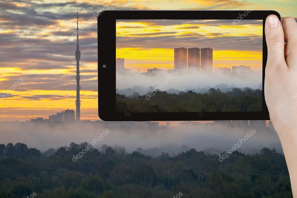 tourist photographs of yellow sunrise in autumn