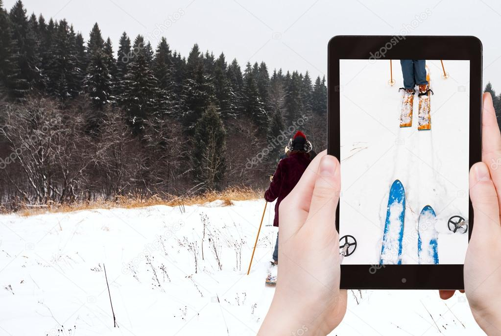 tourist photographs of ski run in snow