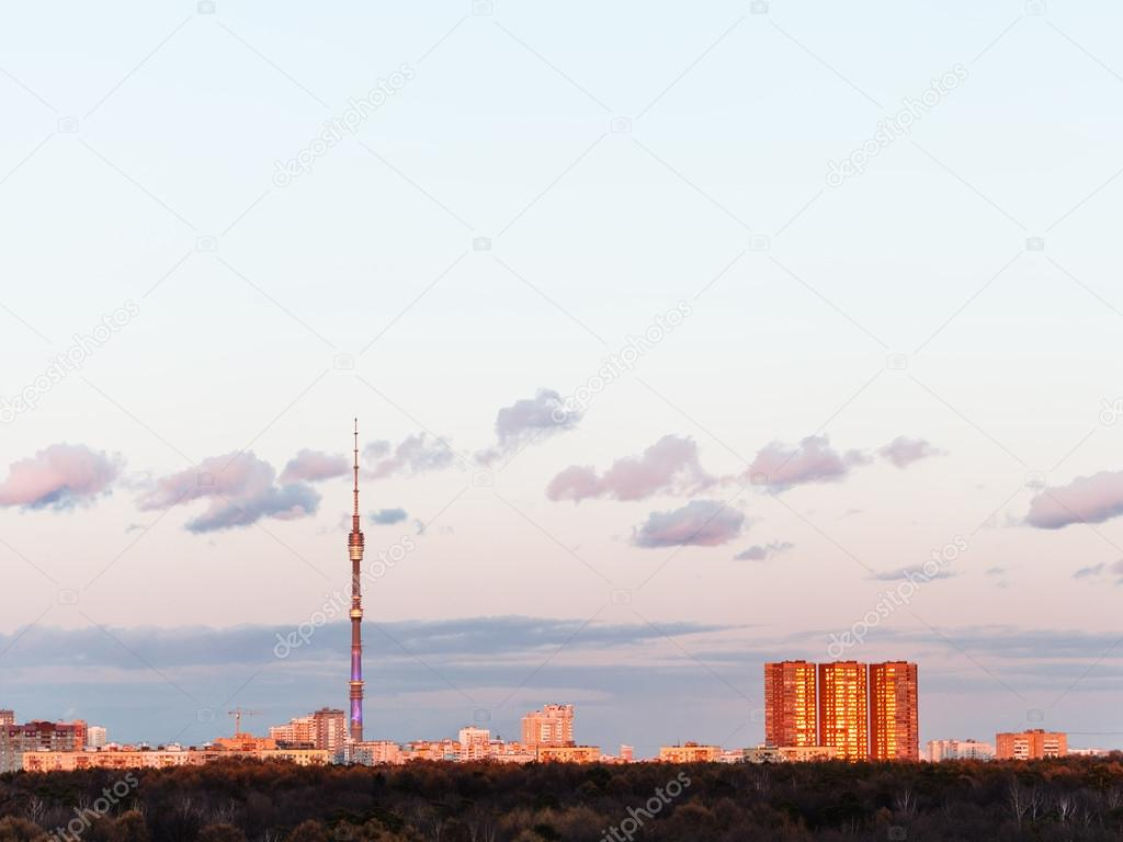 TV tower and city in spring sunset